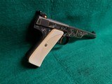 COLT - WOODSMAN. MATCH TARGET. 1ST SERIES. ENGRAVED BY JIM SORNBERGER W-GOLD INLAYS. CHECKERED IVORY GRIPS. STUNNING PISTOL! MFG. IN 1939 - .22 LR - 2 of 17