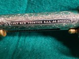 """COLT - NEW FRONTIER S.A.A. 3RD GEN. NICKEL PLATED. 7.5"""" BBL. ENGRAVED BY BRIAN MEARS. CHECKERED IVORY GRIPS. MFG. IN 1981 - .44 SPECIAL - 13 of 18"""