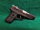 "RUGER - P89DC. ""DECOCKER ONLY"". SEMI-AUTO. BLUED. 4.5"" BBL. W-MAG. GOOD CONDITION. MFG. IN 1993 - 9MM LUGER"