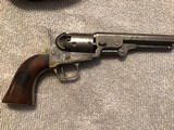 model 1849 colt percussion revolver 5barrel with old leather flap holster.