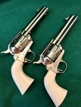 Pair of Colt SAA .45LC 2nd Generation with Holsters and Belt - 1 of 14
