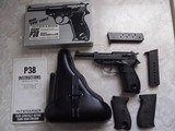 Walther P-38, Coded SVW 45, w/holster, 3 clips and 2 grips; metal and plastic