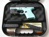 GLOCK 43, 9mm, Gently Used, Robin Egg Blue frame, Streamlight TLR-6, 3 mags, Trijicon site