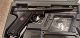 Used Ruger Mark III 22LR with case and extras - 15 of 15