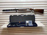 """Used Beretta 686 Silver 12 Gauge 30"""" barrel2 gnarled chokes skt -ic 5 optima chokes 1 cyl1 ic 2 mod 1 full with luggage case and extras"""