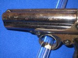 AN EARLY AND SCARCE REMINGTON ELLIOTT FOUR BARREL REPEATING PEPPERBOX DERINGER WITH ORIGINAL CARDBOARD BOX IN FINE UNTOUCHED CONDITION! - 4 of 17