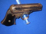 AN EARLY AND SCARCE REMINGTON ELLIOTT FOUR BARREL REPEATING PEPPERBOX DERINGER WITH ORIGINAL CARDBOARD BOX IN FINE UNTOUCHED CONDITION! - 5 of 17