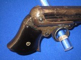 AN EARLY AND SCARCE REMINGTON ELLIOTT FOUR BARREL REPEATING PEPPERBOX DERINGER WITH ORIGINAL CARDBOARD BOX IN FINE UNTOUCHED CONDITION! - 6 of 17