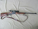 SAVAGE MODEL 99 LEVER ACTION RIFLE 300-SAVAGE CALIBER MANUFACTURED IN 1953 WITH ERA CORRECT HAWK J.UNERTL 4X SCOPE