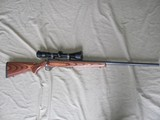 RUGER, 77/22, 22 HORNET CALIBER, DARK GREY, LAMINATED STOCKED, MEDIUM BARREL, BOLT ACTION REPEATER WITH NIKON SCOPE