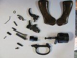 BAG FULL OF ASSORTED PARTS FROM AN RG ROHM 22LR REVOLVER WITH FREE SHIPPING