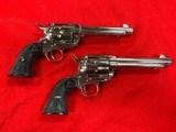 pair of colt nickel sa army 38 40 caliber