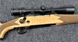 Winchester Model 70 Super Grade Maple in caliber 30/06 with a Zeiss 4X14X44 Scope