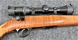 J.G. Anschutz Model 1710 in caliber 22 Long Rifle with a Tiger Stripe stock.