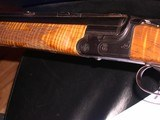 20 ga &6.5x58 1/2 combination gun with beautiful stock and looks as new