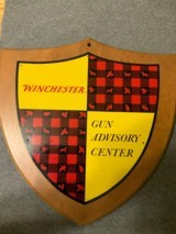 Winchester-gun advisory center wall plaque