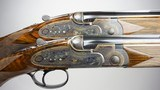 A pre-owned matched pair of CSMC A10 model 20 gauge over & unders with 30 inch barrels