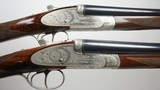 Garbi 28 gauge matched pair of side by side shotguns with 28 inch barrels and fine Rose & Scroll engraving