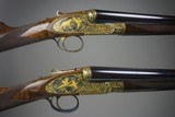 James Purdey left handed deluxe matched pair of 20 gauge side by side self opening shotguns