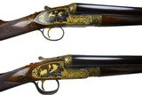 James Purdey left handed deluxe matched pair of 12 gauge side by side self opening shotguns
