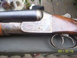 n. r. davis & sons16 ga double barrel by davis warner arms corp, norwich, conn