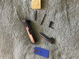 Colt 380 mustang slide, fire pin, spring, extractor - 2 of 3