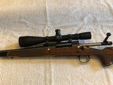 REMINGTON 300 ULTRA MAG MDL 700 BDL LEFT HAND EXCELLENT CONDITION PAIRED WITHLEUPOLD 64660 MK. 4 ER/T M1 FRONT FOCAL RIFLECSOPE 6.5x-20x, 50mm OBJ.