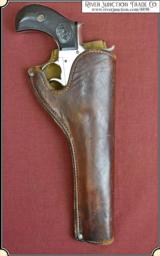 Herman H. Heiser holster for a small frame frontier era revolver