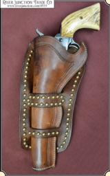 Cheyenne Holster with antiqued brass spots 7-1/2 inch.