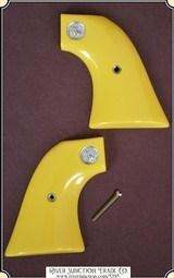 John Wayne yellow new old stock Colt SAA grips