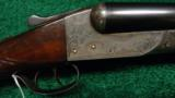 ITHACA DOUBLE BARRELED HAMMERLESS SHOTGUN