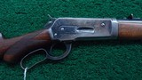 WINCHESTER MODEL 1886 SEMI DELUXE PISTOL GRIP CHECKERED LIGHT WEIGHT RIFLE IN CALIBER 33 WCF