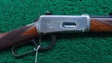 EXTREMELY SCARCE WINCHESTER MODEL 94 DELUXE RIFLE WITH SPECIAL ORDER SILVER TRIM