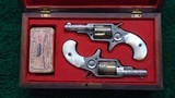 BEAUTIFUL CASED PAIR OF FACTORY ENGRAVED COLT NEW LINE REVOLVERS