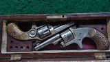 CASED PAIR OF COLT FACTORY ENGRAVED 22 CALIBER PISTOLS