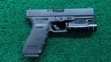 GLOCK 21SF IN 45 ACP WITH FLASHLIGHT