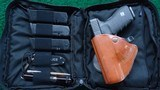 GLOCK 21 IN 45 ACP IN CARRY BAG WITH EXTRA MAGS - 14 of 14