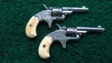 CASED PAIR OF 22 CALIBER DELUXE ENGRAVED OPEN TOP COLT REVOLVERS