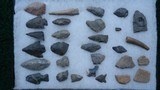 COLLECTION OF SCRAPERS, ARROWHEADS, POTTERY SHARDS AND WHAT APPEARS TO BE A PIECE OF TOOTH