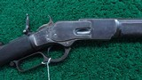 WINCHESTER 1ST MODEL 1873 DELUXE RIFLE IN CALIBER 44-40 - 1 of 21