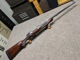 Jack Haugh custom 458 Win. Mag. rifle, engraved and mint.