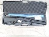 "Girsan MC-12 in 12 gauge pump shotgun, 28"" takedown barrel with factory case and multi-choke inserts."