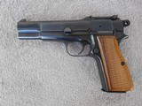 Manufactured in Belgium, this Browning Hi Power with tangent sight in 9 mm manufactured in 1966 is in at least very good+ to excellent condition.