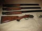 SKB Model 585 O/U 3 Barrel Set. 20ga, 28 ga, & 410 ga. 28 inch barrels- 10 of 12