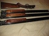 SKB Model 585 O/U 3 Barrel Set. 20ga, 28 ga, & 410 ga. 28 inch barrels- 12 of 12