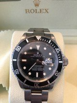 RolexSubmariner Date black face stainless steel watch automatic