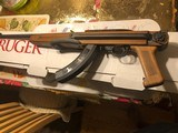 "Ruger 10/22 LR with walnut under folder stock "" New unfired """