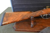 """Fausti Style Side-by-Side 12 Gauge Shotgun With 28"""" Multi-Choke Barrels – Beautiful Engraving and Highly Figured Wood – Cased – Excellent"""
