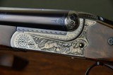 """Merkel 147EL 20 Gauge Boxlock Ejector with 30"""" Barrels, Highly Figured Stock and Long Length of Pull – Profusely Game Scene Engraved by Bettina Lenk"""