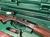 LIKE NEW REMINGTON 1100 410 GAUGE SHOTGUN WITH REMOVABLE REM CHOKE TUBE GUN IS LIKE NEW PERFECT ALL AROUND COMES WITH REMINGTON CASE